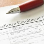Closeup of Medicare enrollment form and pen